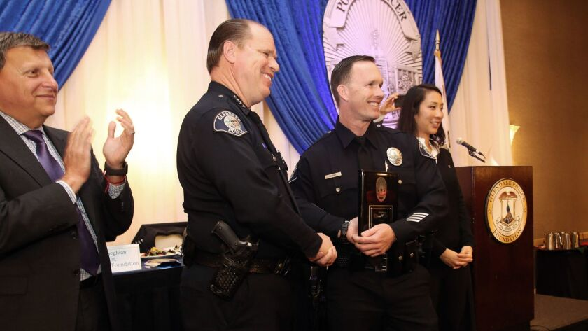 Glendale Police Officer Justin Darby is awarded the Glendale Police Officer of the Year during the 2