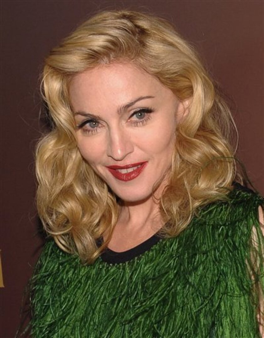 In this Nov. 19, 2008 file photo, singer Madonna attends a Gucci UNICEF dinner at The Oak Room at the Plaza in New York. A full-frontal, nude photo of a 20-year-old Madonna fetched $37,500 at auction Thursday, possibly setting a record auction price for a photograph of the superstar singer, Christie's auction house said. (AP Photo/Evan Agostini, file)