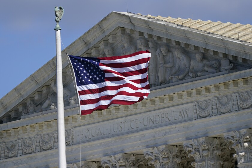 An American flag waves in front of the Supreme Court building in Washington, D.C.