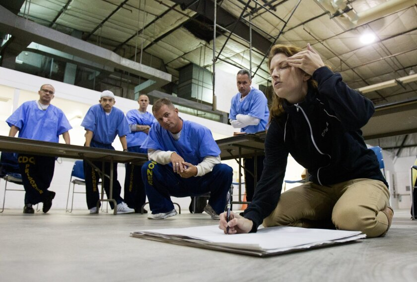 Inside Donovan State Prison there is a new program exposing inmates to art by the name of Project Paint which teaches the basics of drawing and painting.  Tara Smith Centybear shows inmates how to do a blind contour self portrait as they watch.