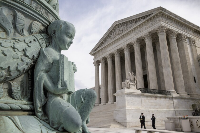 "A cherub holding an open book adorns a flagpole on the plaza of the Supreme Court in Washington, D.C. The justices ruled on Monday in a case involving the constitutional principle of ""one person, one vote."""