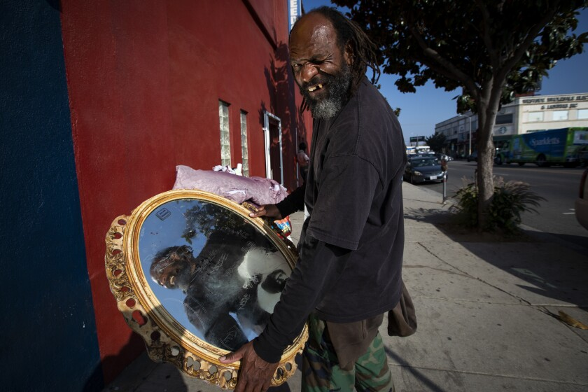 Bumdog Torres with a mirror outside the New Beverly Cinema