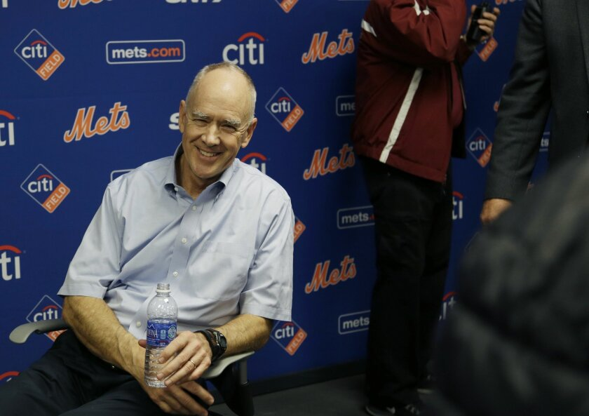 New York Mets general manger Sandy Alderson rests in a chair after collapsing during a news conference in New York, Wednesday, Nov. 4, 2015. (AP Photo/Seth Wenig)