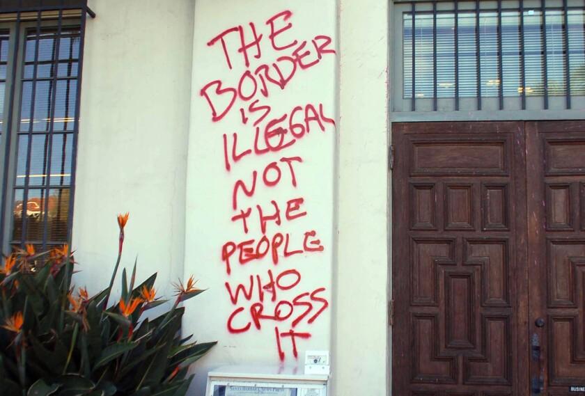 Graffiti is splattered on the entrance to the Santa Barbara News-Press building in Santa Barbara.