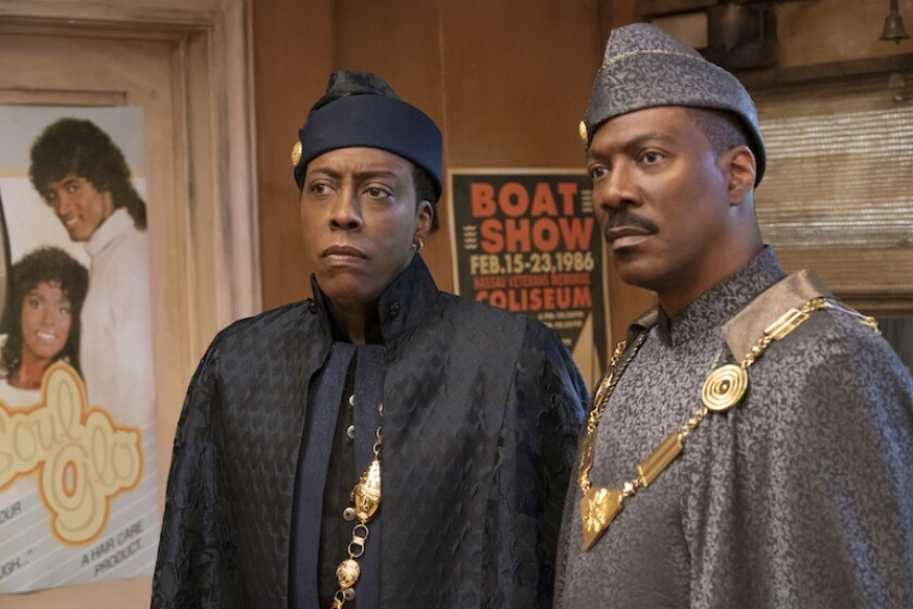 "Arsenio Hall and Eddie Murphy in ""Coming 2 America."""