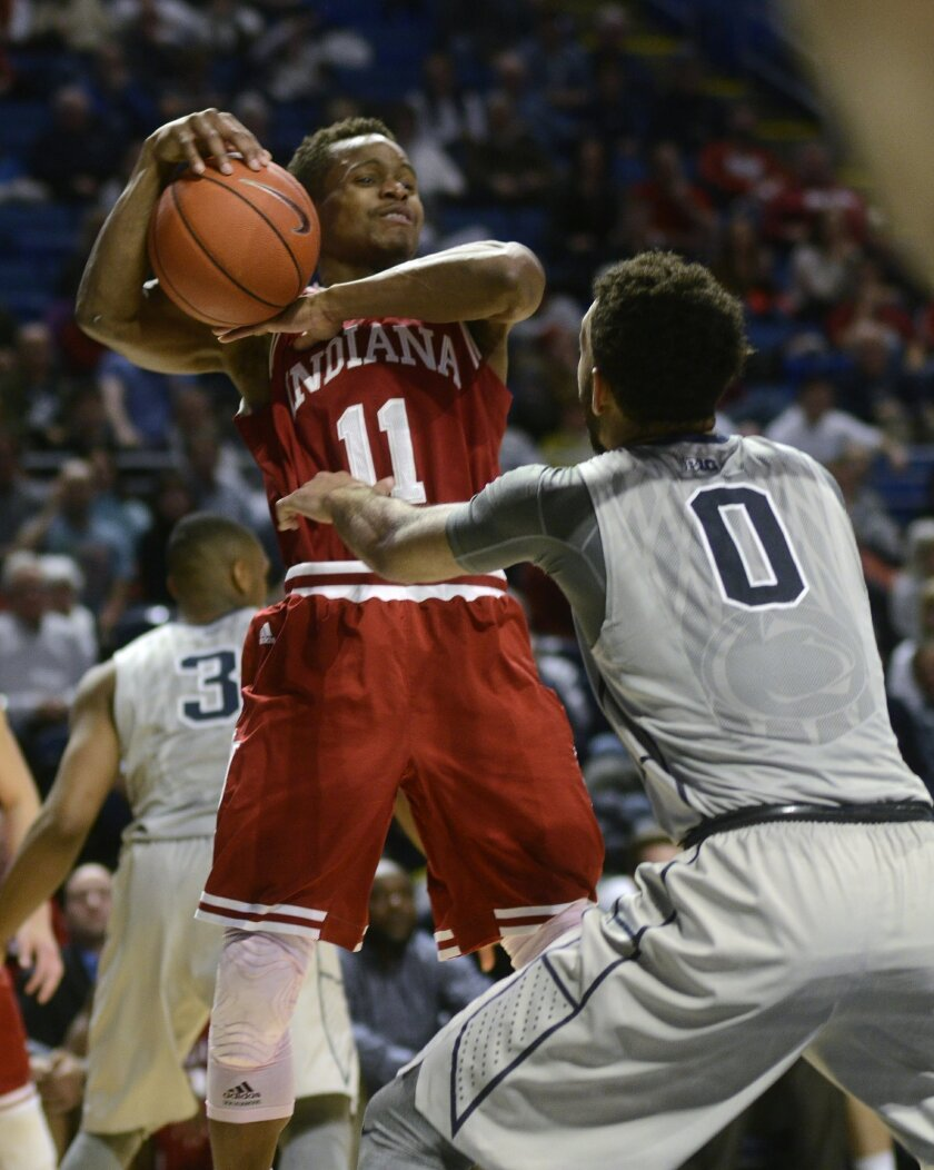 Indiana's Kevin Yogi Ferrell (11) looks to pass against Penn State's Payton Banks (0) during the second half of an NCAA college basketball game in State College, Pa., Saturday, Feb. 6, 2016. Penn State won 68-63. (AP Photo/Ralph Wilson)