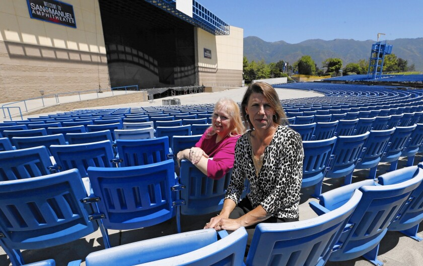 Valerie Henry, left, president of the Devore Rural Protection Assn., and Karen Slobom are pushing for an end to electronic dance events at San Manuel Amphitheater in Devore. Slobom is angry that the festivals have continued even though people died.