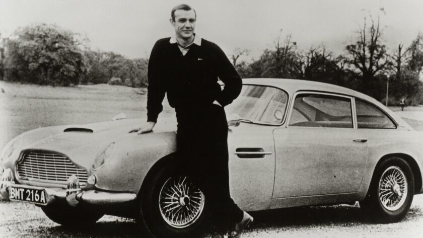 """Sean Connery with an Aston Martin DB5 for the James Bond film """"Goldfinger."""""""