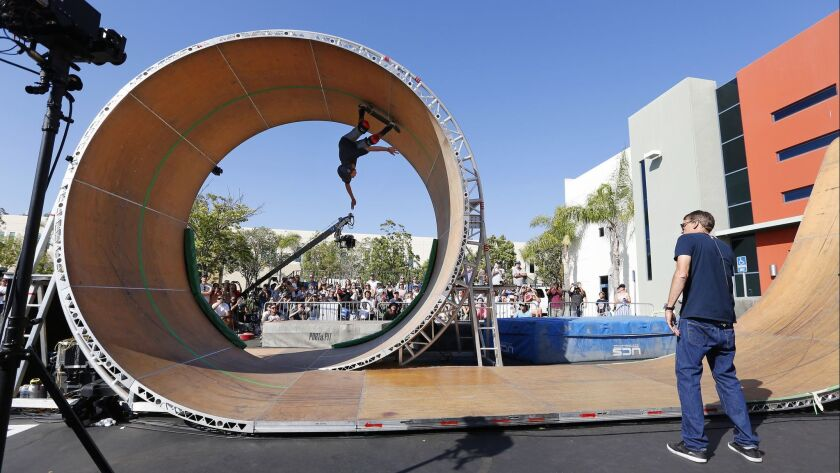 Tony Hawk, right, watches skater Jeromy Green complete the Loop Challenge Live in Vista on Sunday.