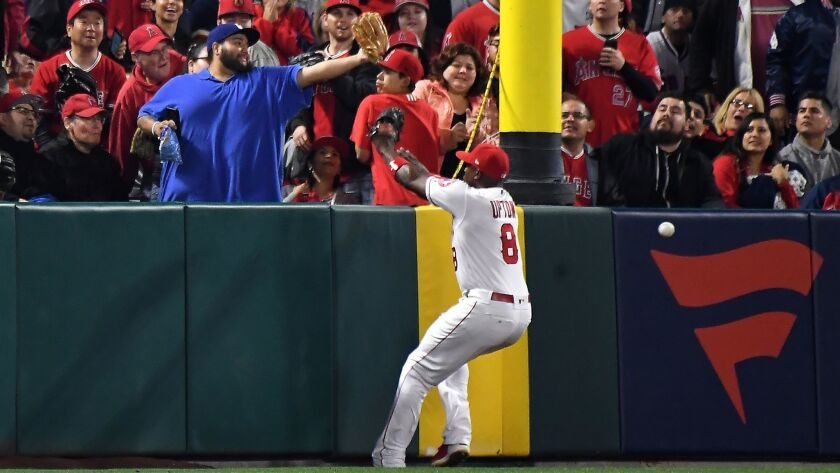 Angels left fielder Justin Upton can't make the catch on an inside-the-park home run by Indians batter Edwin Encarnacion in the second inning on April 2.