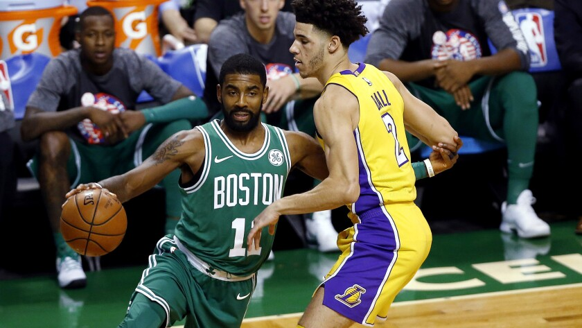Celtics guard Kyrie Irving drives past Lakers guard Lonzo Ball during the first quarter Wednesday night in Boston