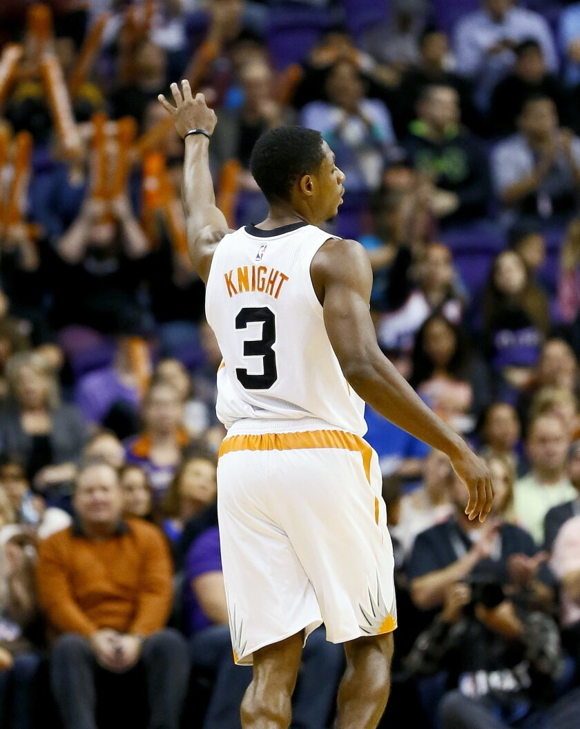 Phoenix Suns' Brandon Knight (3) signals three against the Sacramento King' during the second half of an NBA basketball game, Wednesday, Nov. 4, 2015, in Phoenix. (AP Photo/Matt York)