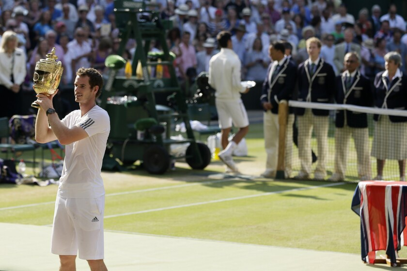 FILE - In this July 7, 2013, filemphoto, Andy Murray of Britain poses with the trophy after defeating Novak Djokovic of Serbia in the men's singles final match at the All England Lawn Tennis Championships in Wimbledon, London. (AP Photo/Alastair Grant, File)