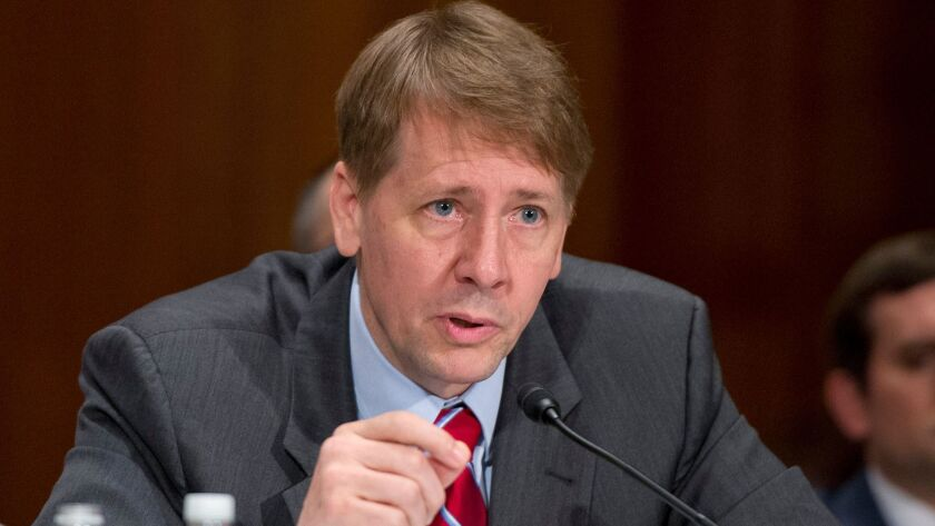 Richard Cordray, director of the Consumer Financial Protection Bureau, testifies about Wells Fargo at a Senate committee hearing in September.