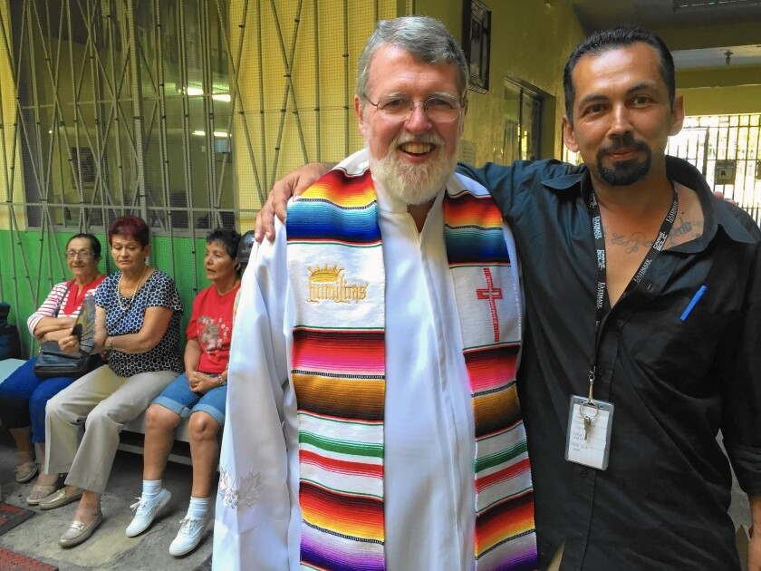 Casa del Migrante Director Father Patrick Murphy, 63, with Juan Carlos Garcia Aguilar, 39, of Bakersfield, who was deported to Mexico after serving a drug sentence. His five children are in Bakersfield.