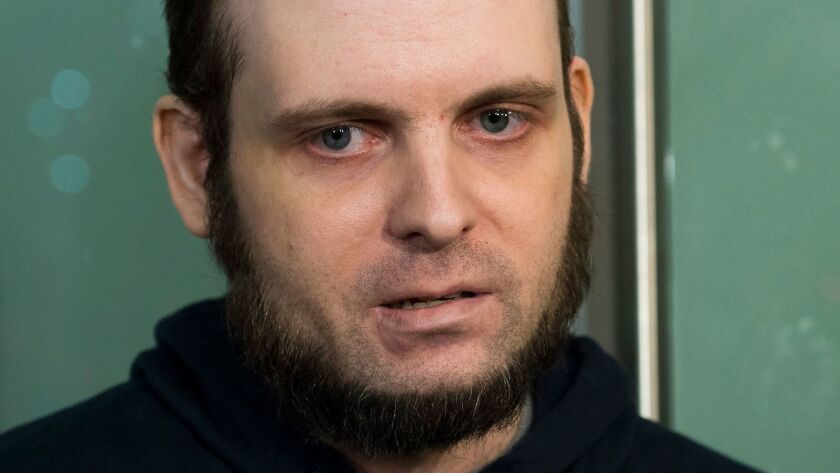 Joshua Boyle speaks to the media on Oct. 31, 2017, after arriving at Pearson International Airport in Toronto.