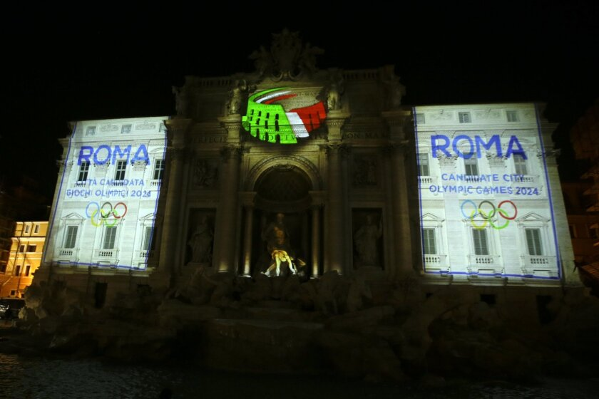 FILE - In this Dec. 14, 2015, file photo, the logo for the candidacy of Rome for the 2024 Olympic games is projected on the Trevi Tountain in Rome. For some reason, four cities submitted bids this week to host the 2024 Olympics, turning in glitzy presentations filled with all sorts of highfalutin i