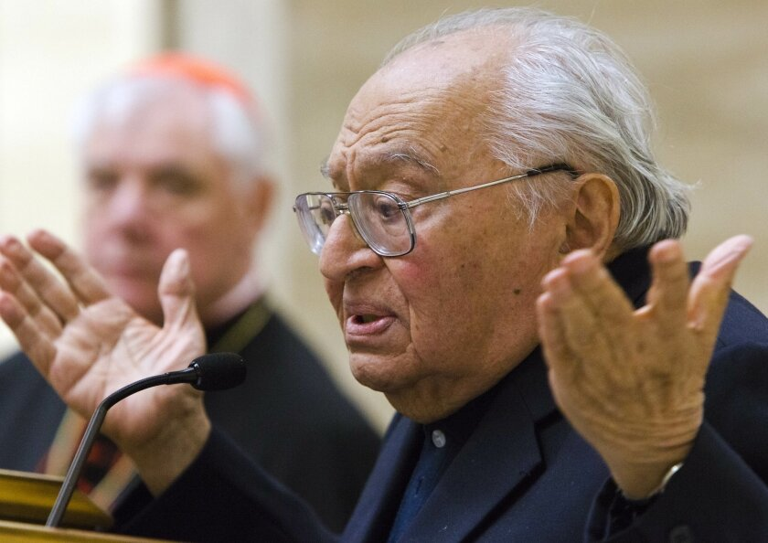 """Peruvian theologian Gustavo Gutierrez speaks during the presentation of the book, to which he contributed, """"Poor for the poors, the mission of the Church"""" by Cardinal Gerhard Ludwig Mueller, background, in Vatican City, Tuesday, Feb. 25, 2014. Gutierrez is considered the father of the Liberation theology for his 1971 book """"Teologia de la liberation. Prospectivas"""" (Theology of Liberation. Perspectives). (AP Photo/Domenico Stinellis)"""