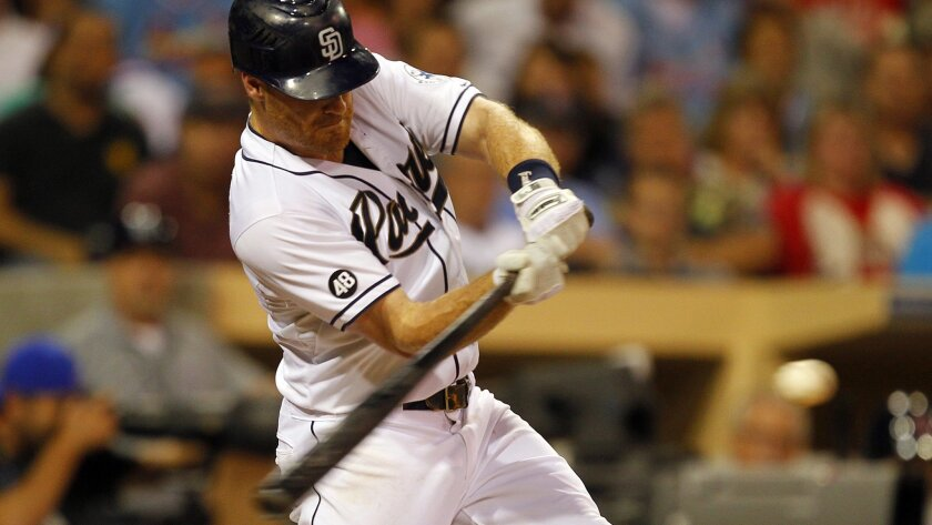 Logan Forsythe strokes a two-run double in the Padres' win over the Cardinals.