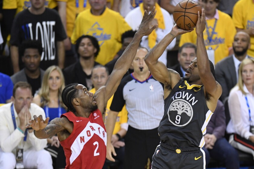 Golden State Warriors forward Andre Iguodala (9) shoots over Toronto Raptors forward Kawhi Leonard (