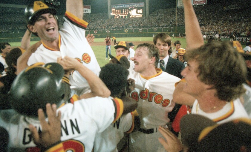 Teammates give Steve Garvey a boost after he hit a game-winning home run to boost the Padres past the Cubs in 1984 NLCS.