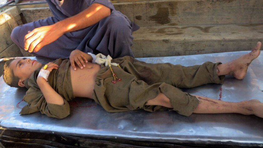 An injured Pakistani blast victim arrives at a hospital Friday following a suicide bombing at a mosque in the Mohmand tribal district.