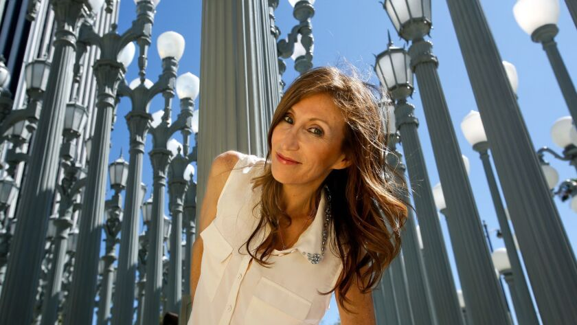 LOS ANGELES, CA-AUGUST 5, 2013: Los Angeles based author Francesca Lia Block is photographed next t