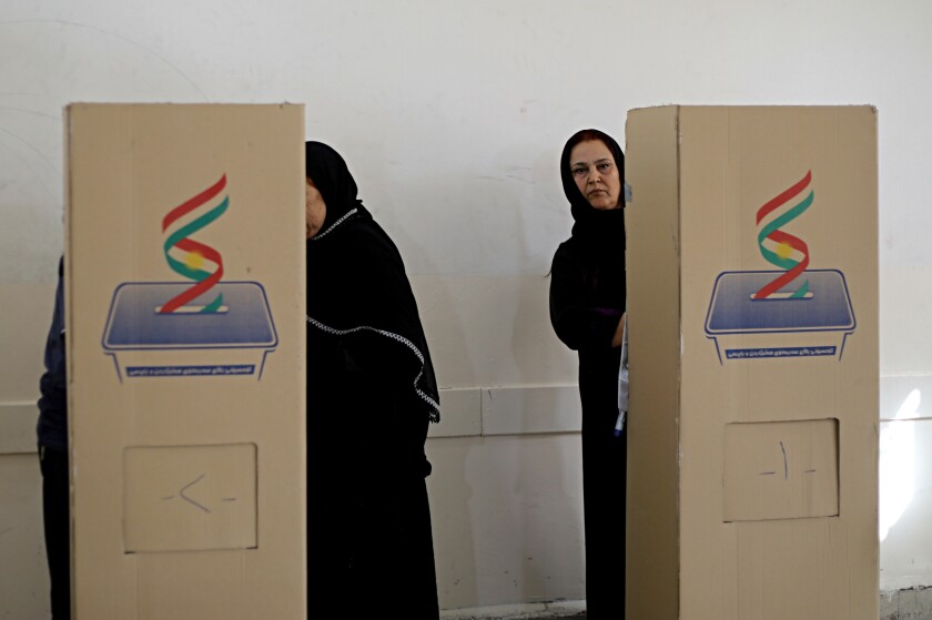 FILE - In this Sept. 30, 2018 file photo, Iraqi Kurdish women cast their ballots during parliamentary elections in Irbil, Iraq. With the help of the United Nations, authorities in Iraq are taking measures to prevent voter fraud in national elections in October 2021. The U.N. envoy to Iraq Jeanine Hennis-Plasschaert stressed on Tuesday, Sept. 7, 2021 while speaking to reporters in Baghdad, that Iraqi political parties and candidates must abstain from intimidation, voter suppression and bribes to ensure the federal elections are free and fair. (AP Photo/Salar Salim, File)