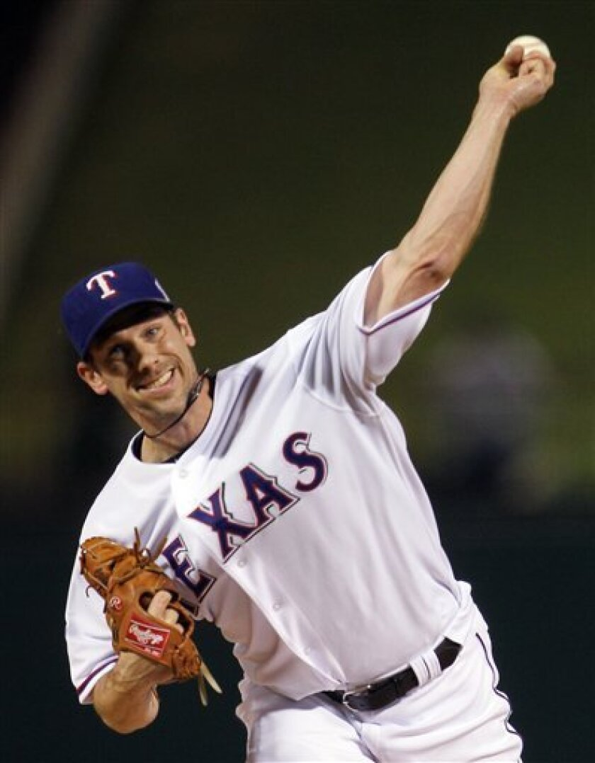Texas Rangers' Cliff Lee throws during the first inning of Game 5 of baseball's World Series against the San Francisco Giants Monday, Nov. 1, 2010, in Arlington, Texas. (AP Photo/Doug Pensinger, Pool)