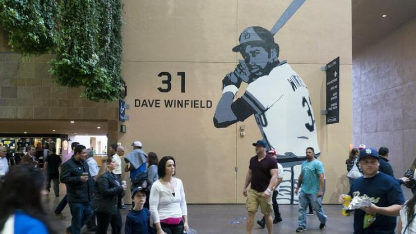 Iconic photos of four Padres players with retired numbers, including Dave Winfield, who are also in the Padres Hall of Fame were turned into murals by Cherie Hayek Morgan and placed Petco Park. (Gary Payne)