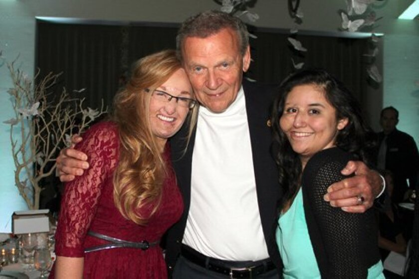Tom Goodman with two angels. Courtesy Photo