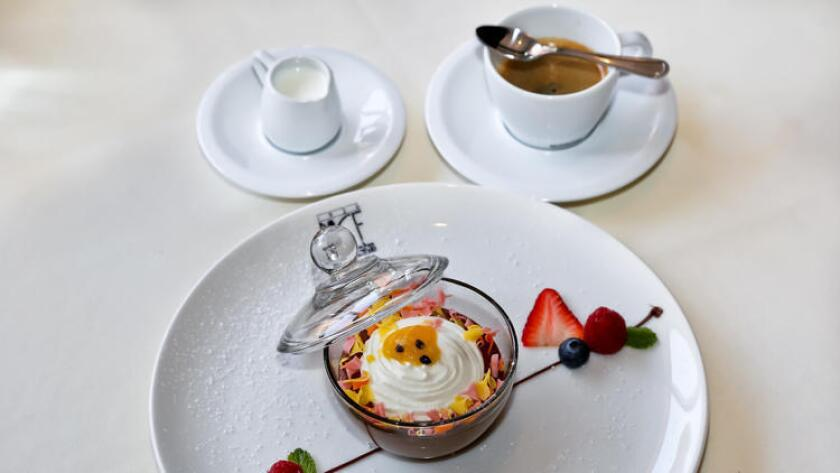 The upscale Italian restaurant in the Gaslamp Quarter has a new dark chocolate mousse dessert served in a covered glass dish with passion fruit sauce, whipped cream and fresh fruit. (Bice)