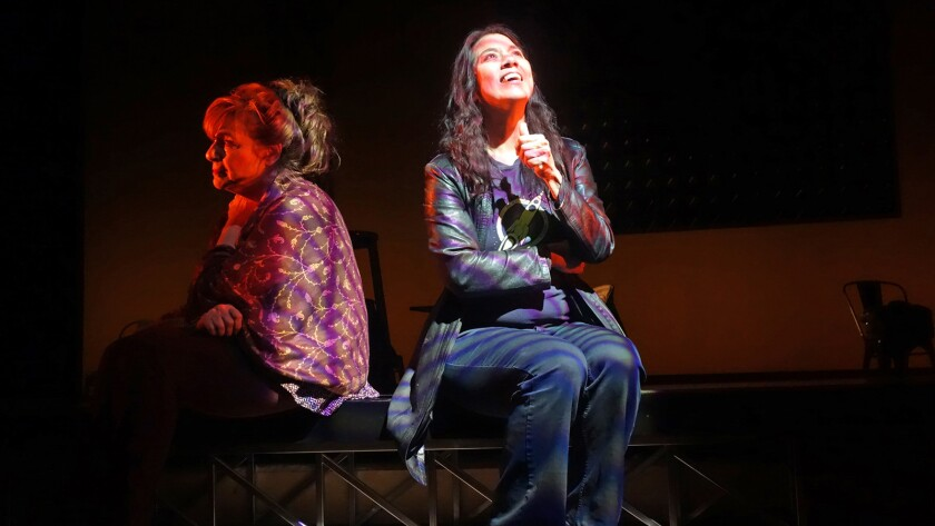 """A scene from """"The Madwoman in the Volvo"""" with Sandra Tsing Loh, right."""