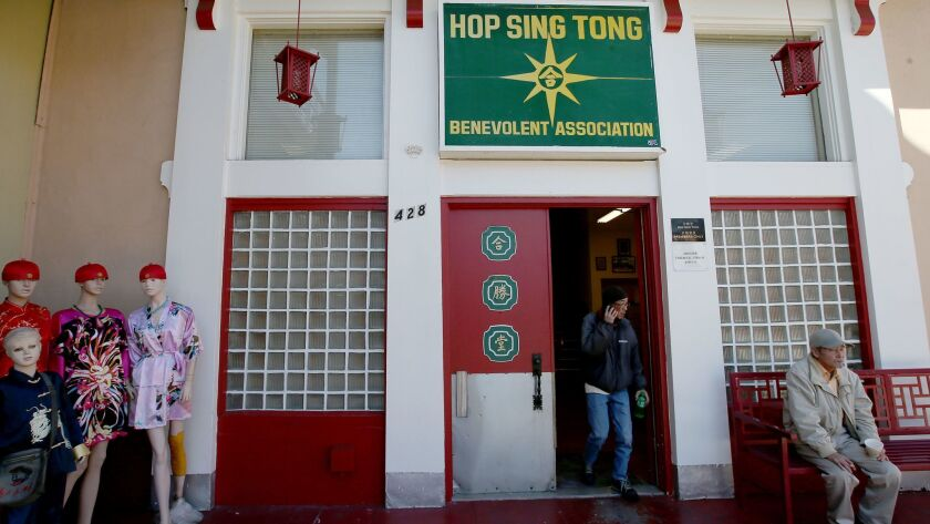 Two men were stabbed to death at the Hop Sing Tong.