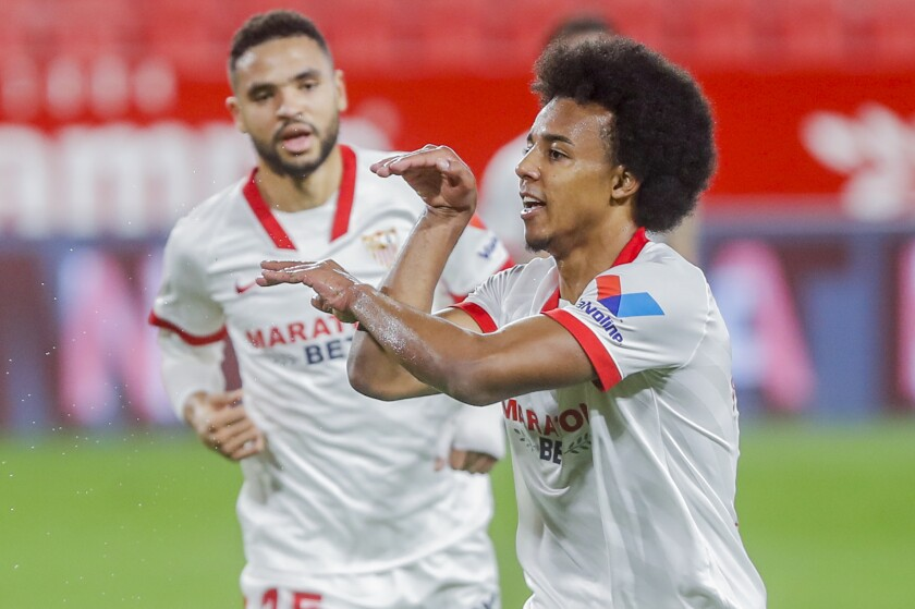 Sevilla's Jules Kounde celebrates after scoring his side's first goal during a Spanish Copa del Rey semifinal soccer match between Sevilla and FC Barcelona at Ramon Sanchez Pizjuan stadium in Seville , Spain, Wednesday, Feb. 10, 2021. (AP Photo/Angel Fernandez)