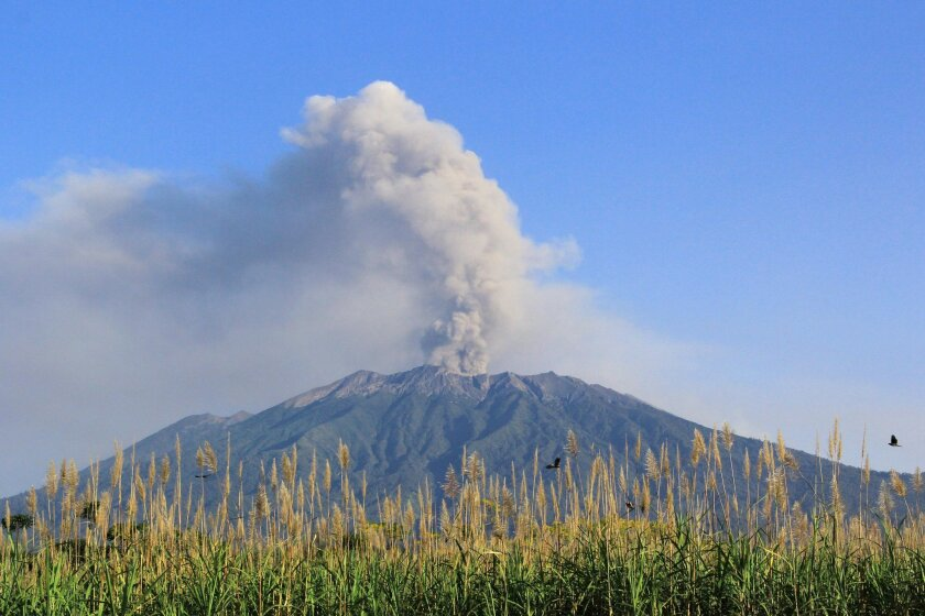 Mount Raung spews volcanic material into the air as seen from Songgon, East Java, Indonesia, Thursday, July 23, 2015. The eruption of Mount Raung on the main island of Java has caused the airport to close for several hours on Wednesday, disrupting flights to and from the resort island.(AP Photo)