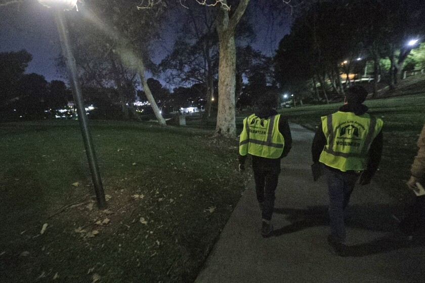 Volunteers Josh Lord and Josh Fryday, both from Gov. Gavin Newsom's office, walk in Brace Canyon Park in Burbank looking for homeless people on Tuesday as part of the Greater Los Angeles Homeless Count.