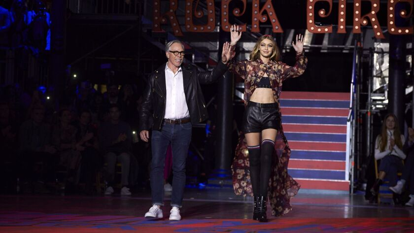 Tommy Hilfiger and Gigi Hadid greet the crowd after the TommyNow fashion show in London on Sept. 19.