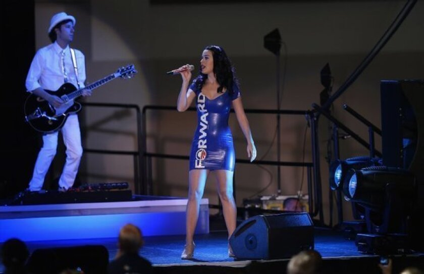 Katy Perry wears her political views on her dress a a campaign rally for President Barack Obama on Saturday.
