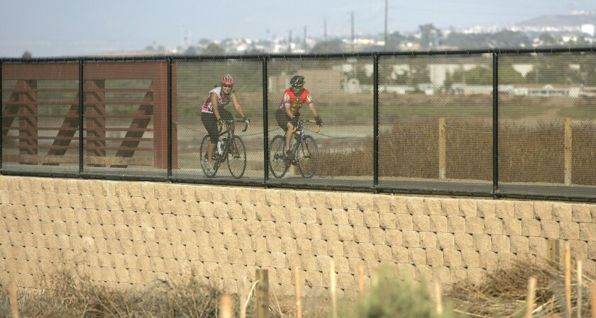 Bicyclists ride on a stretch of the 24-mile Bayshore Bikeway in Imperial Beach. Biker-friendly businesses are envisioned nearby. (Earnie Grafton / Union-Tribune)