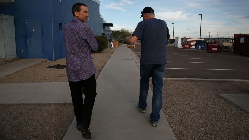 Peter Siedler (l), Padres managing partner gets an up close look at the homeless campus, Central Arizona Shelter Services  in Phoenix with Mike McQuaid.