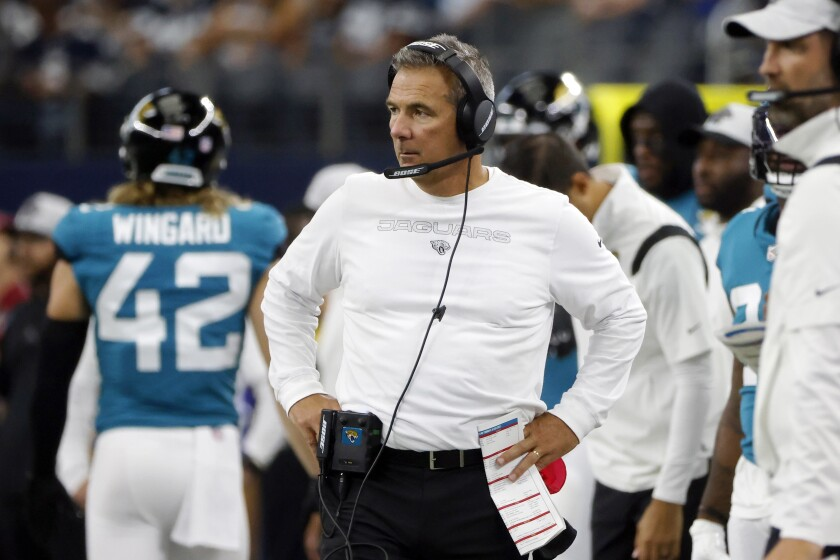FILE - In this Sunday, Aug. 29, 2021, file photo ,Jacksonville Jaguars heads coach Urban Meyer, center, watches play in the first half of a preseason NFL football game against the Dallas Cowboys in Arlington, Texas. Meyer, unbeaten in season openers, will try to extend his 17-0 record when the Jaguars travel to Houston for their season opener. (AP Photo/Michael Ainsworth, File)