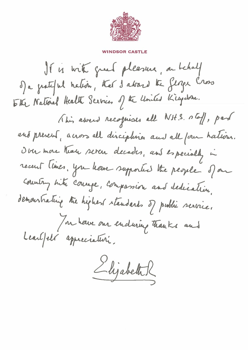 """This undated handout issued by Buckingham Palace on Sunday, July 4, 2021 shows a copy of the handwritten message from Queen Elizabeth II in support of the award of the George Cross to the UK's National Health Services (NHS). The George Cross is granted in recognition of """"acts of the greatest heroism or of the most courage in circumstances of extreme danger"""", and recognises actions by civilians and military personnel not in the face of the enemy. (Buckingham Palace via AP)"""