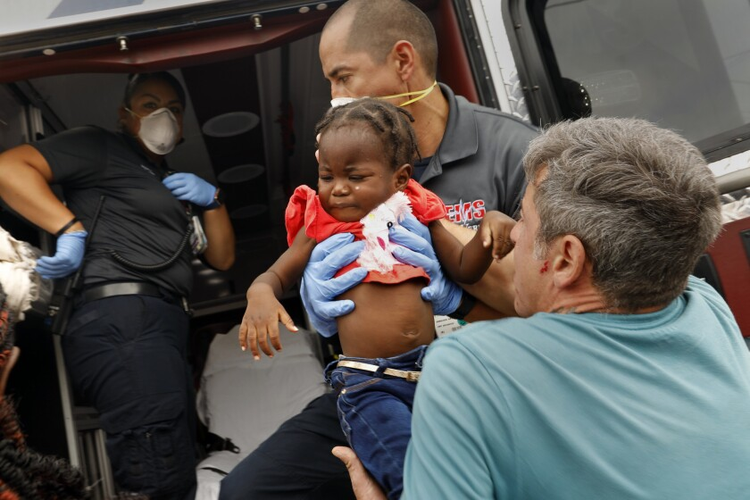 DEL RIO, TEXAS, JUNE 20, 2019--A sick migrant child is taken to the hospital after she and her mothe