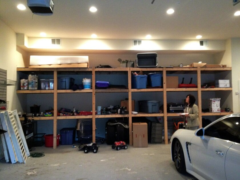 In this 2012 photo provided by Tailored Living/Premier Garage, a 4-car garage is seen before being transformed into a useful and more attractive space. More and more owners are turning to professionals to help them renovate their garages. Advances in flooring and storage products make it easier tha