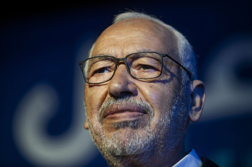 """FILE - In this Oct. 3, 2019 file photo, Islamist party leader and parliament speaker Rached Ghannouchi speaks during a meeting in Tunis, Tunisia. Rached Ghannouchi said on Tuesday July 27, 2021, that his party is working to form a """"national front"""" to counter President Kais Saied's decision to suspend the legislature, fire top government officials and take control of the fragile democracy amid the country's multi-layered crisis. (AP Photo/Hassene Dridi, File)"""