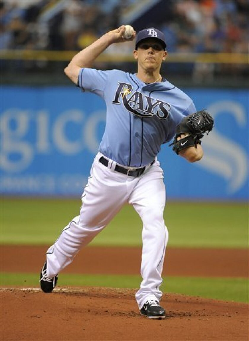 Tampa Bay Rays starting pitcher Jeremy Hellickson delivers to the New York Yankees during the first inning of a baseball game Sunday, April 8, 2012, in St. Petersburg, Fla. (AP Photo/Brian Blanco)