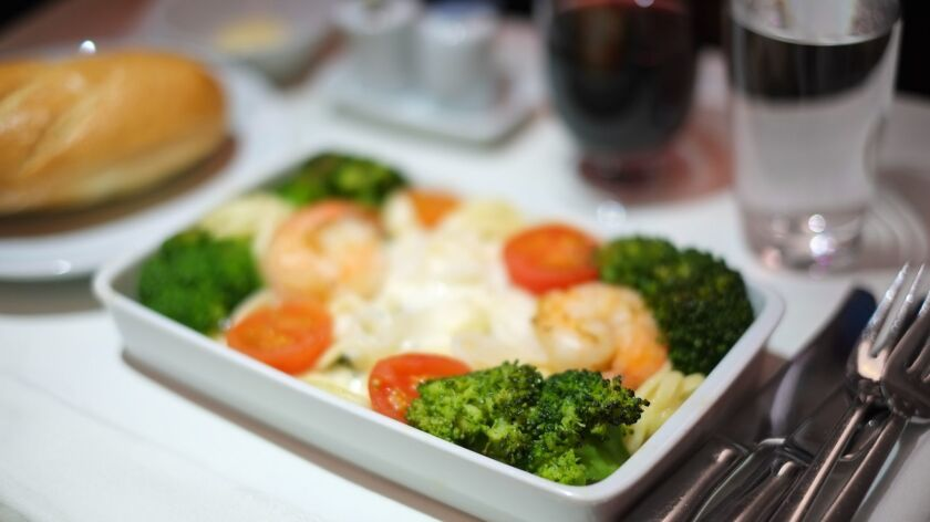 A passenger insists he wants an entree that's no longer available in business class. If you're the flight attendant, what do you to when he loudly insists that's what he wants?