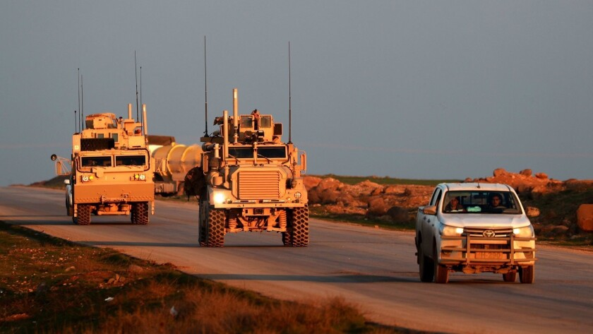 U.S. Marine Corps vehicles are escorted by a Syrian Democratic Forces pickup truck near the town of Tal Baydar in northeastern Syria's Hasakah province on Dec. 21, 2018.