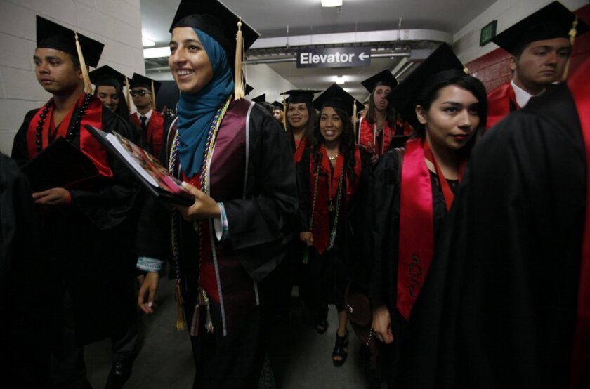 Thousands of students said farewell to San Diego State University Friday, with three separate graduation ceremonies filing through Viejas Arena.